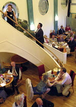 'THE FULL MONTEVERDI' ~performers on stairs and at table at bottom of stairs~I Fagiolini / Cheltenham International Festival of Music   The Daffodil Restaurant             05/07/2004