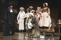 THE HYPOCHONDRIAC (Le Malade Imaginaire)   by Moliere   directed by: Michael Bogdanov,left: Robert Oates (Monsieur Purgon)   kneeling: Daniel Massey (Argan)   standing right: Polly James (Toinette),Ol...