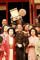 MADAM BUTTERFLY   by Puccini   director: David Freeman <br>,the wedding photo - front left: Ai-Lan Zhu (Cio-Cio San/Madam Butterfly)   centre: Gerard Powers (Pinkerton),Royal Albert Hall, London SW7...