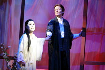 MADAM BUTTERFLY   by Puccini   director: David Freeman <br>,Pinkerton leads his new bride to bed: Ai-Lan Zhu (Cio-Cio San/Madam Butterfly), Gerard Powers (Pinkerton),Royal Albert Hall, London SW7...