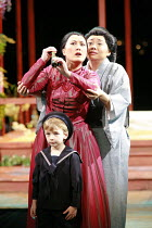 MADAM BUTTERFLY   by Puccini   director: David Freeman <br>,looking out for Pinkerton^s ship,l-r: Ai-Lan Zhu (Cio-Cio San/Madam Butterfly), Zheng Cao (Suzuki) with Carlo Fucci (Sorrow),Royal Albert Ha...