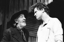 DESIRE UNDER THE ELMS  by Eugene O'Neill  design: Joe Vanek  lighting: Mick Hughes  director: Patrick Mason <br>~l-r: Tom Hickey (Ephraim Cabot), Colin Firth (Eben)~Greenwich Theatre, London SE10  11/...