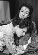 DESIRE UNDER THE ELMS  by Eugene O'Neill  design: Joe Vanek  lighting: Mick Hughes  director: Patrick Mason <br>~Colin Firth (Eben), Carmen du Sautoy (Abbie)~Greenwich Theatre, London SE10  11/05/1987...