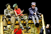 'DIARY OF AN ACTION MAN' (Kenny)~l-r: Amit Sharma (Ezra), David Ellington (Dad), Karen Spicer (Little Girl), Cherylee Houston (Mother)~Graeae Theatre Company & Unicorn / Stratford Circus, London E15...