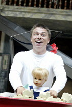 'DIDO, QUEEN OF CARTHAGE' (Marlowe - 'Master of Play': Tim Carroll)   2003 Season of Regime Change~James Garnon (Cupid) with doll of Ascanius (grandson of Venus)~Shakespeare's Globe, London SE1...