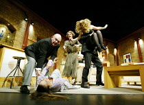 'DAMSELS IN DISTRESS' (Ayckbourn)~'RolePlay': l-r  Robert Austin (Derek Jobson), (on stage) Saskia Butler (Julie-Ann Jobson), Beth Tuckey (Dee Jobson), (carried off) Alison Pargeter (Paige Petite)~Duc...
