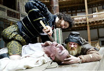 'EDWARD II' (Marlowe)   (director: Timothy Walker)~top: Justin Avoth (Lord Maltravers)   being 'shaved': Liam Brennan (Edward II)   right: Albie Woodington (Gurney)~Shakespeare's Globe, London SE1...