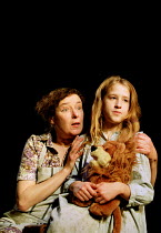 FAR AWAY by Caryl Churchill  design: Ian MacNeil  director: Stephen Daldry ~ ~l-r: Linda Bassett (Harper), Annabelle Seymour-Julen (Young Joan)~Jerwood Theatre Upstairs, Royal Court Theatre, London SW...