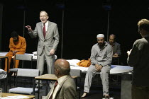 'GUANTANAMO: �Honor Bound to Defend Freedom' ' (Victoria Brittain & Gillian Slovo - directed by Nicolas Kent & Sacha Wares) 2nd left/standing: William Hoyland (Donald Rumsfeld) Tricycle Theatre, Lon...