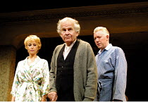THE HOMECOMING by Harold Pinter set design: Eileen Diss costumes: Dany Everett lighting: Mick Hughes director: Robin Lefevre ~l-r: Lia Williams (Ruth), Ian Holm (Max), Nick Dunning (Teddy)~Gate Theatr...