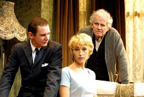THE HOMECOMING by Harold Pinter set design: Eileen Diss costumes: Dany Everett lighting: Mick Hughes director: Robin Lefevre ~l-r: Ian Hart (Lenny), Lia Williams (Ruth), Ian Holm (Max)~Gate Theatre, D...
