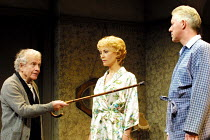 THE HOMECOMING by Harold Pinter set design: Eileen Diss costumes: Dany Everett lighting: Mick Hughes director: Robin Lefevre ~l-r: Ian Holm (Max), Lia Williams (Ruth), Nick Dunning (Teddy)~Gate Theatr...