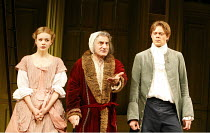 THE HYPOCHONDRIAC   by Moliere   in a new version by Richard Bean   director: Lindsay Posner,l-r: Carey Mulligan (Ang�lique), Henry Goodman (Argan), Kris Marshall (Cl�ante),Almeida Theatre, London N1...