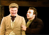 'NICHOLAS NICKLEBY' (Part 1) (David Edgar after Dickens)~l-r: Richard Riddell (Wackford Squeers), Rafe Spall (Squeers)~National Youth Theatre/Lyric Theatre Hammersmith, London W6  30/08/2001