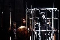 THE ORESTEIA , by Aeschylus , in a version by Tony Harrison , design: Jocelyn Herbert assisted by Sue Jenkinson , lighting: John Bury , movement: Stuart Hopps , director: Peter Hall ,~Cassandra caged~...
