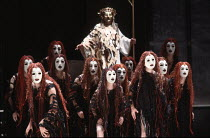 rear centre: Apollo  with Furies in THE ORESTEIA by Aeschylus at the Olivier Theatre, National Theatre (NT), London SE1 28/11/1981 ~in a version by Tony Harrison  design: Jocelyn Herbert assisted by S...