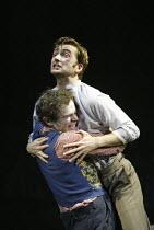 'THE PILLOWMAN' (Martin McDonagh - director: John Crowley)~l-r: Adam Godley (Michal), David Tennant (Katurian)~Cottesloe Theatre / National Theatre, London SE1        13/11/2003