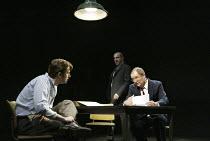 'THE PILLOWMAN' (Martin McDonagh - director: John Crowley)~l-r: David Tennant (Katurian), Nigel Lindsay (Ariel), Jim Broadbent (Tupolski)~Cottesloe Theatre / National Theatre, London SE1        13/11/...