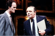 PRAVDA  written & directed by David Hare  set design: Hayden Griffin  costumes: Lindy Hemming <br>~l-r: Tim McInnerny (Andrew May), Anthony Hopkins (Lambert le Roux)~Olivier Theatre, National Theatre...