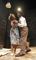 A RAISIN IN THE SUN  by Lorraine Hansberry  director: David Lan <br> Noma Dumezweni (Ruth Younger), Lennie James (Walter Lee Younger),Young Vic Theatre Company / Lyric Hammersmith, London W6...