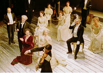 'REMEMBRANCE OF THINGS PAST' (Proust/Pinter/Trevis) entertaining guests chez Madame Verdurin: Oliver Williams (as Charles Morel, violinist in foreground) with (front row, l-r) Janine Duvitski (Mme V...