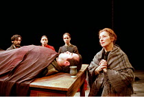 'RIDERS TO THE SEA' (J.M. Synge - director: John Crowley)~l-r: Lalor Roddy (Neighbour), Mairead McKinley (Cathleen), Aislinn Mangan (Nora), Stella McCusker (Maurya) with (dead on table) Stephen Kenned...