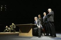 transatlantic 'phone call - at left, Nicholas Farrell (Tony Blair)   at right, l-r: Alex Jennings (George W Bush), Adjoa Andoh (Condoleeza Rice), Dermot Crowley (Donald Rumsfeld), Desmond Barrit (Dick...