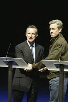 l-r: Nicholas Farrell (Tony Blair), Alex Jennings (George W Bush) in STUFF HAPPENS by David Hare at the Olivier Theatre, National Theatre (NT), London SE1  10/09/2004~design: Christopher Oram  lightin...