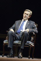 Alex Jennings (George W Bush) in STUFF HAPPENS by David Hare at the Olivier Theatre, National Theatre (NT), London SE1  10/09/2004~design: Christopher Oram  lighting: Paul Anderson  director: Nicholas...