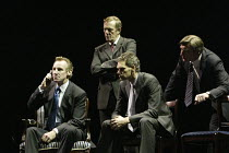 making a transatlantic 'phone call - at left, Nicholas Farrell (Tony Blair) with advisors in STUFF HAPPENS by David Hare at the Olivier Theatre, National Theatre (NT), London SE1  10/09/2004~design: C...