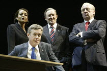 Alex Jennings (George W Bush) with (l-r) Adjoa Andoh (Condoleeza Rice), Dermot Crowley (Donald Rumsfeld), Desmond Barrit (Dick Cheney) in STUFF HAPPENS by David Hare at the Olivier Theatre, National T...