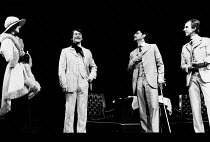 'TRAVESTIES' (Stoppard)~l-r: Maria Aitken (Gwendolen Carruthers), John Hurt (Tristan Tzara), Tom Bell (James Joyce), John Wood (Henry Carr)~Royal Shakespeare Company (RSC), Aldwych Theatre, London WC2...