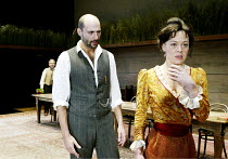 'UNCLE VANYA' (Friel/after Chekhov - directed by Sam Mendes)~l-r: Simon Russell Beale (Vanya), Mark Strong (Astrov), Helen McCrory (Yelena)~Donmar Warehouse. London WC2          17/09/2002