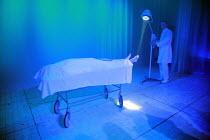 PEER GYNT   by Henrik Ibsen   director: Baltasar Kormakur <br>,on the trolley, under the sheet: Bjorn Hlynur Haraldsson (Peer Gynt)   right: Ingvar E. Sigurdsson (Button Moulder),National Theatre of I...