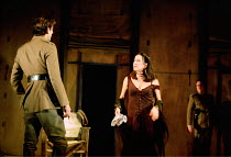 OTHELLO  by Shakespeare  design: Robert Jones  lighting: Peter Mumford  fights: Terry King  director: Michael Attenborough ~Cassio with Bianca (holding the handkerchief), watched by Iago - l-r: Henry...