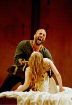 OTHELLO  by Shakespeare  design: Robert Jones  lighting: Peter Mumford  fights: Terry King  director: Michael Attenborough ~V/ii: Ray Fearon (Othello), Zoe Waites (Desdemona) ~Royal Shakespeare Compan...