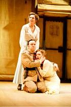 OTHELLO  by Shakespeare  design: Robert Jones  lighting: Peter Mumford  fights: Terry King  director: Michael Attenborough ~Iago pretends to comfort distraught Desdemona - (top) Rachel Joyce (Emilia),...