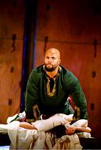 OTHELLO  by Shakespeare  design: Robert Jones  lighting: Peter Mumford  fights: Terry King  director: Michael Attenborough ~final act, Othello smothers Desdemona: Ray Fearon (Othello)~Royal Shakespear...