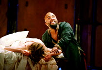 OTHELLO  by Shakespeare  design: Robert Jones  lighting: Peter Mumford  fights: Terry King  director: Michael Attenborough ~final act, Othello agonises by Desdemona's body: Ray Fearon (Othello)~Royal...