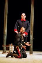 OTHELLO  by Shakespeare  design: Robert Jones  lighting: Peter Mumford  fights: Terry King  director: Michael Attenborough ~(rear) Richard McCabe (Iago), Ray Fearon (Othello)~Royal Shakespeare Company...
