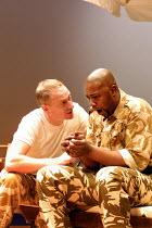 'OTHELLO' (Shakespeare)~l-r: Rupert Wickham (Iago), Nicholas Monu (Othello)~Theatre Unlimited/Cochrane Theatre, London WC1               31/01/2002