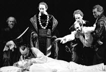 'OTHELLO' (Shakespeare)~Iago (David Suchet, right) restrained as Othello (Ben Kingsley) caresses dead Desdemona (Niamh Cusack)~RSC/Barbican Theatre, London EC1   01/1986