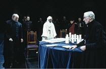 'OTHELLO' (Shakespeare - director: Bill Alexander),I/iii - left: Stuart Richman (Brabantio)  rear left: Hilton McRae (Iago)   centre: Jeffery Kissoon (Othello)   right: Bill McGuirk (Duke of Venice) ,...