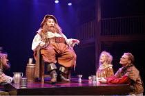 HENRY IV part i  by Shakespeare  design: Neil Patel  lighting: Ken Billington  director: Barbara Gaines ~l-r: Kevin Gudahl (Bardolph), Greg Vinkler (Sir John Falstaff), Lusia Strus (Mistress Quickly),...