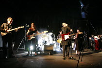 ATTEMPTS ON HER LIFE   by Martin Crimp   director: Katie Mitchell <br>,musicians, from left: Michael Gould, Liz Kettle. (on drums, obscured by smoke) Claudie Blakley, Paul Ready, Zubin Varla,Lyttelton...