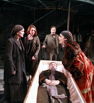 """DYING FOR IT   by Moira Buffini   freely adapted from THE SUICIDE by Nikolai Erdman   ,directed by Anna Mackmin <br>,fighting over the """"body"""" - l-r: Liz White (Maria Lukianovna/Masha), Sophie Stanton..."""