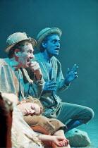 THE TEMPEST  by Shakespeare  designer: Robert Innes Hopkins  lighting: Peter Mumford  director: Jude Kelly ~l-r: Ian McKellen (Prospero), Paul Bhattacharjee (Ariel) with (on Prospero's lap) Claudie Bl...