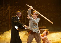 THE TEMPEST  by Shakespeare  designer: Robert Innes Hopkins  lighting: Peter Mumford  director: Jude Kelly ~l-r: Rashan Stone (Ferdinand), Ian McKellen (Prospero), Claudie Blakley (Miranda)~West Yorks...