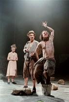 THE TEMPEST  by Shakespeare  designer: Robert Innes Hopkins  lighting: Peter Mumford  director: Jude Kelly ~l-r: Claudie Blakley (Miranda), Ian McKellen (Prospero), Timothy Walker (Caliban)~West Yorks...