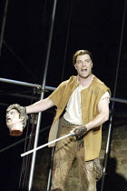 'CYMBELINE' (Shakespeare - director: Michael Bogdanov)~Bradley Freegard (Guiderius) with Cloten's head~Ludlow Castle / England    26/06/2004